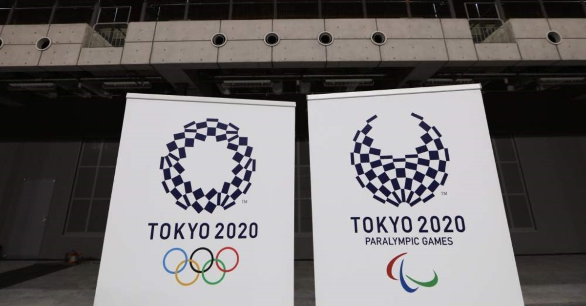 Logos for the Tokyo 2020 Olympics and Paralympics, are displayed at a grand opening ceremony of the Ariake Arena, Tokyo, Feb. 2, 2020. (AP Photo)