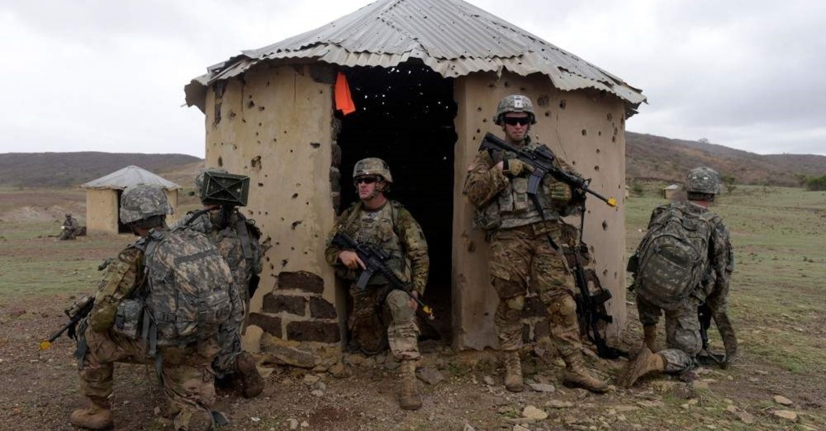 This July 25, 2016, file photo shows American soldiers taking position near a hut during a combined training exercise with Senegalese 1st Paratrooper Battalion in Thies, Senegal. (AFP Photo)