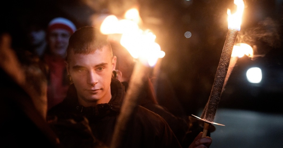 In this Wednesday, Nov. 9, 2016 file photo, demonstrators hold torches during a far-right Thuegida rally in Jena, Germany. (AP Photo)