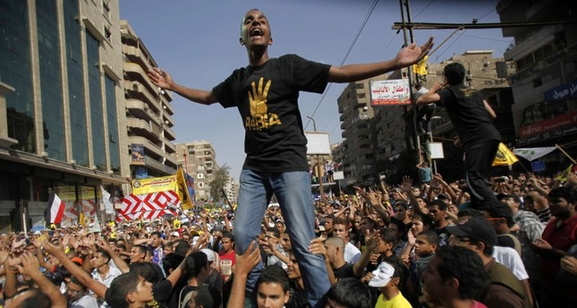 Members of the Muslim Brotherhood and supporters of ousted Egyptian President Mohamed Mursi shout slogans during a protest against the military near Rabaa al-Adaweya square in Cairo Oct. 4, 2013 (Reuters File Photo)