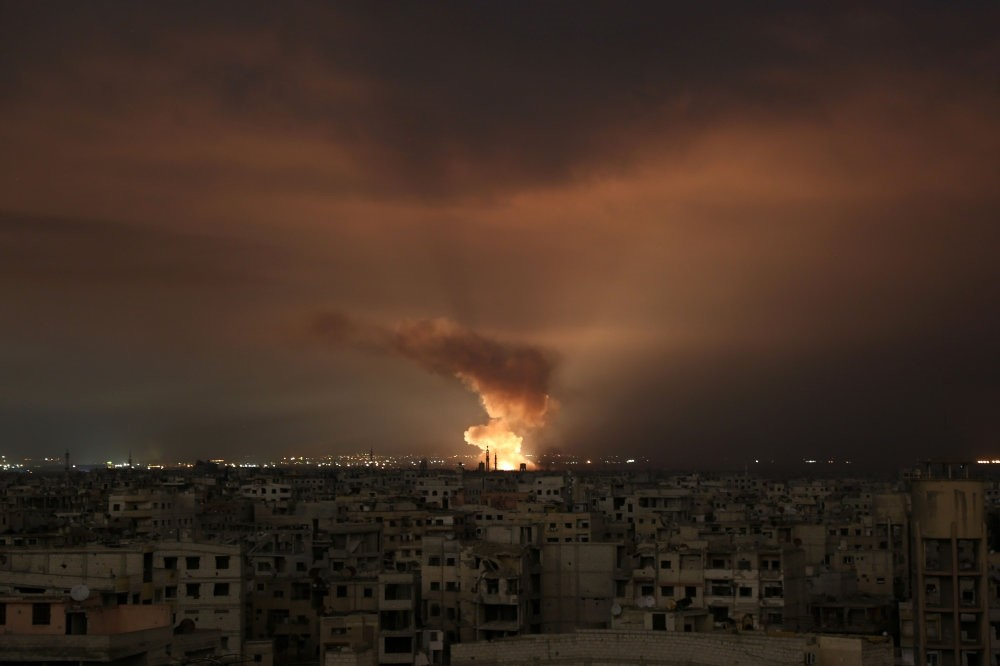 Smoke billows following an Assad regime air strike on the Eastern Ghouta region on the outskirts of the capital Damascus, Feb. 23.