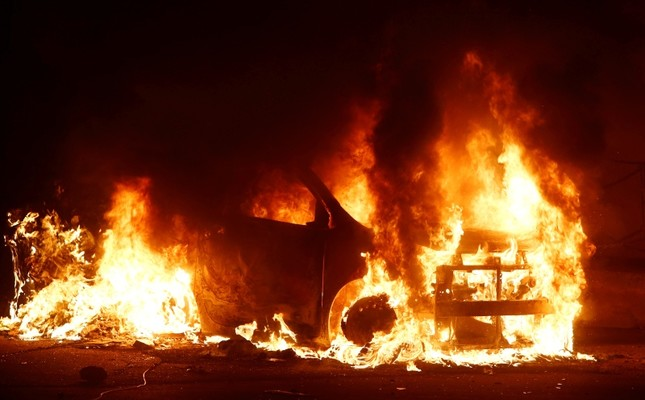 A burning vehicle is seen during riots at Hal Far Open Center migrant camp in Hal Far, Malta, Oct. 21, 2019. (Reuters Photo)
