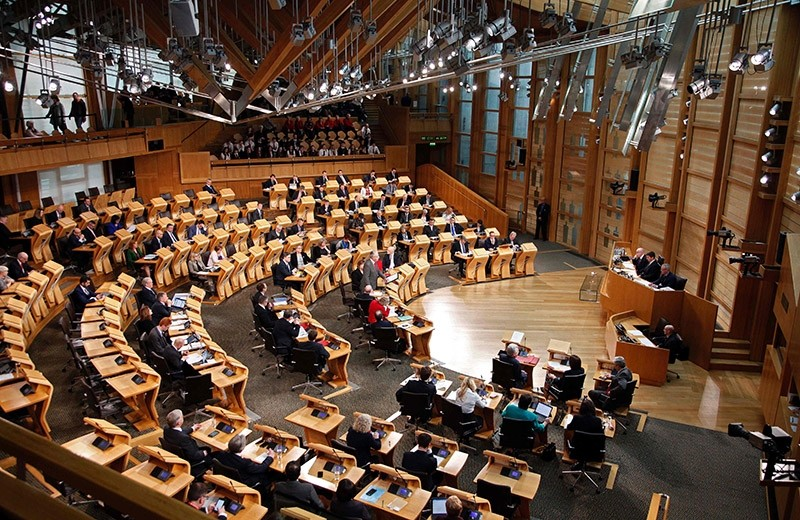 A handout photo made available from the Scottish Parliament on Feb. 7, 2017, shows Minister Michael Russell, standing at a lecturn as he opens the Scottish Government debate on Article 50 inside the Scottish Parliament in Edinburgh. (AFP Photo)