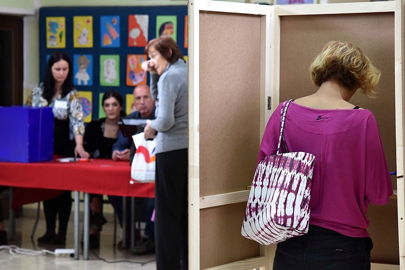 A woman prepares her ballot at the polling station in Montenegro's capital Podgorica, Sunday, April 15, 2018. (AP Photo)