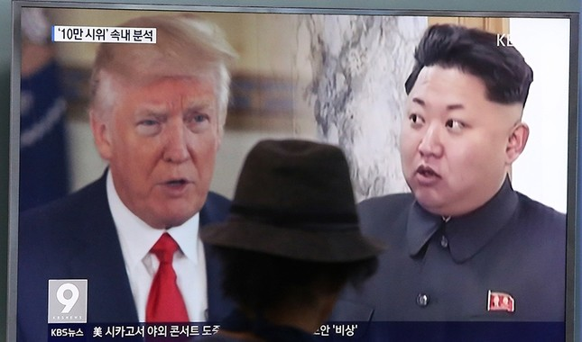 In this Aug. 10, 2017, file photo, a man watches a television screen showing U.S. President Donald Trump and North Korean leader Kim Jong Un during a news program at the Seoul Train Station in Seoul, South Korea. (AP Photo)