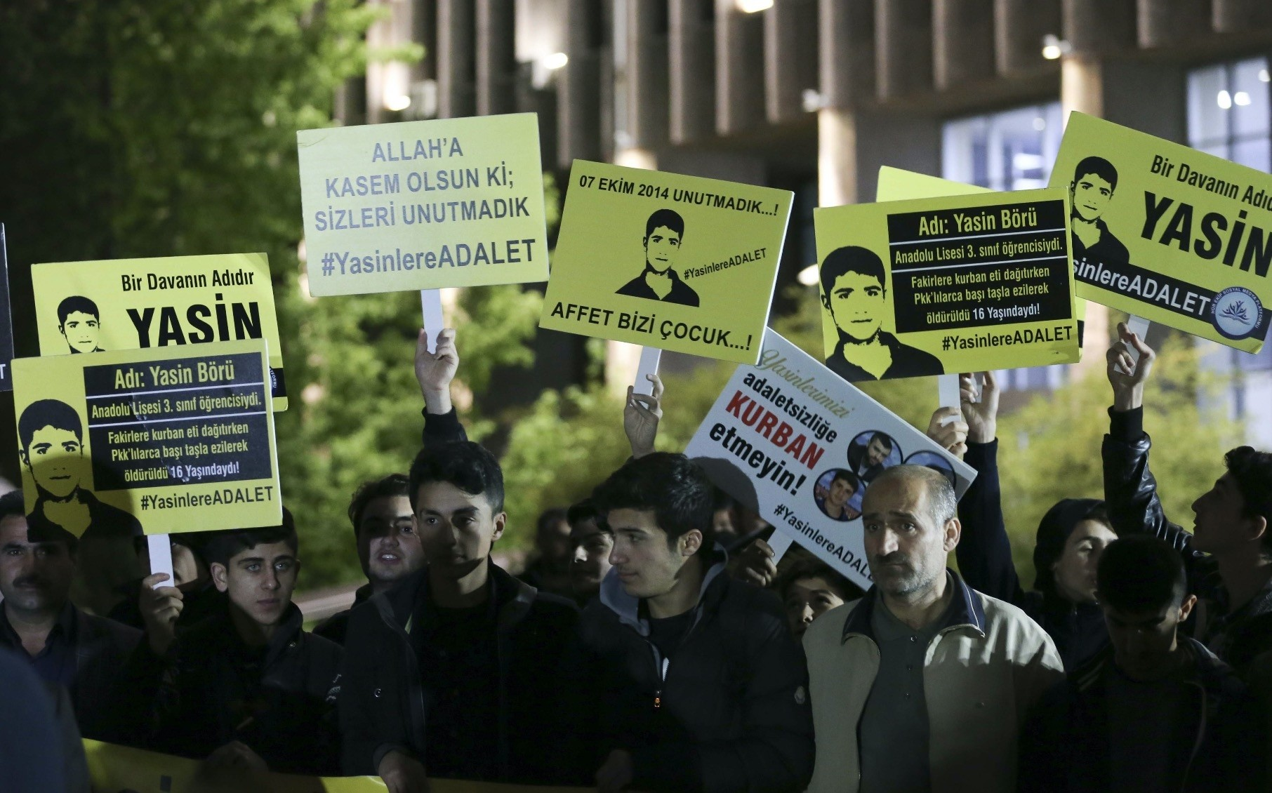 People stage a rally outside an Ankara courthouse, holding banners with pictureS of Yasin Bu00f6ru00fc, the teenage victim of PKK riots in Diyarbaku0131r, after a trial of those accused of killing Bu00f6ru00fc and his three friends.