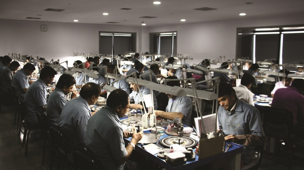 Workers in a diamond cutting workshop in Surat, India.