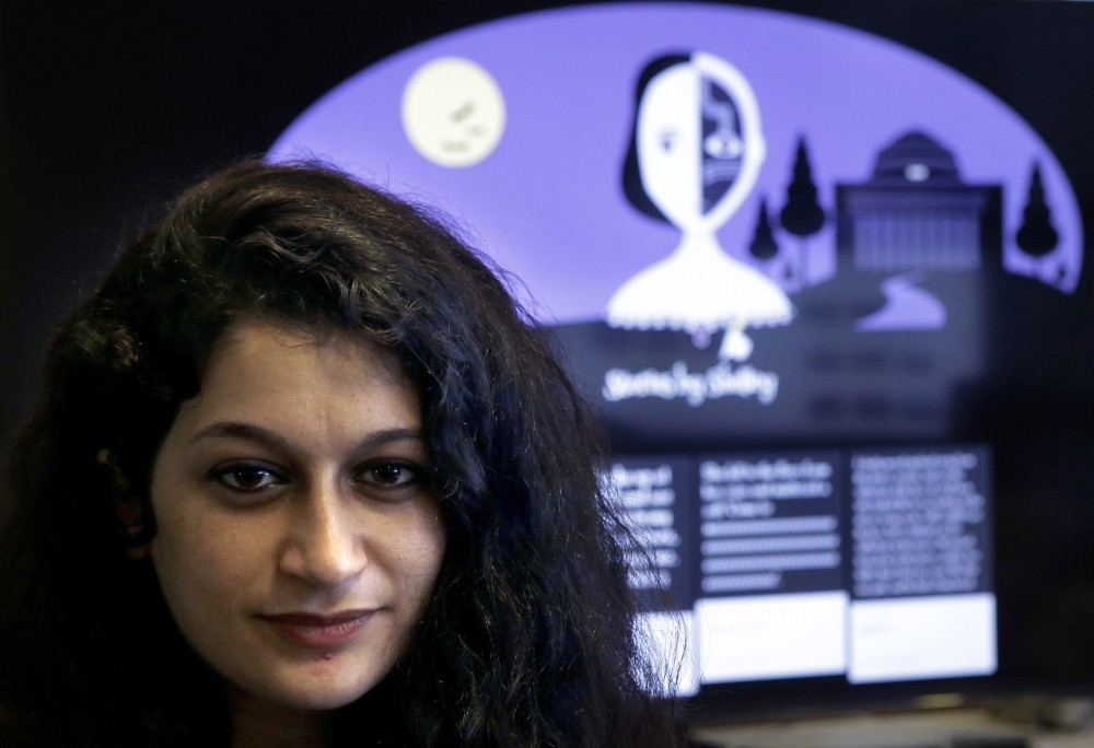 Co-creator of a fiction-writing u201cchatbot,u201d  Massachusetts Institute of Technology  postdoctoral associate Pu0131nar Yanardau011f of  Istanbul, poses in front of a graphic from the home page of the site called u201cShelley.u201d