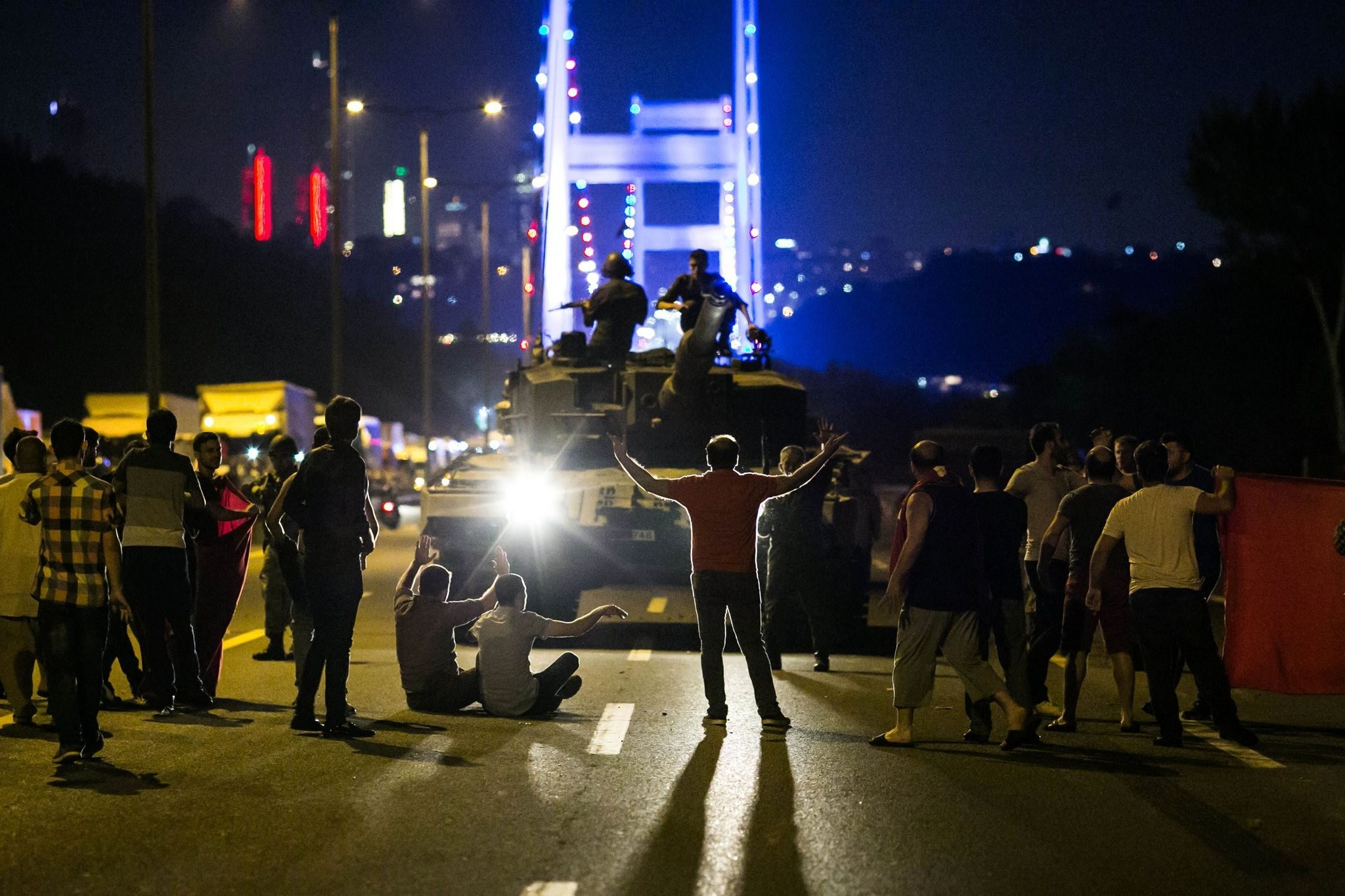 People taking over a tank near Istanbulu2019s Fatih Sultan Mehmet bridge during clashes with the Gu00fclenist coup plotters who were staging a coup attempt in the night of July 15, 2016.