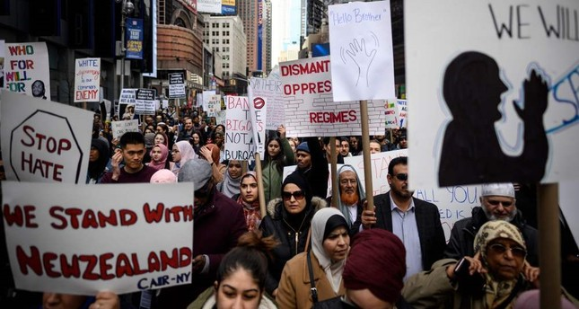 Demonstrators take part in a protest against growing Islamophobia, white supremacy and anti-immigrant bigotry following the New Zealand mosque attacks, at in Times Square, New York City, the U.S.