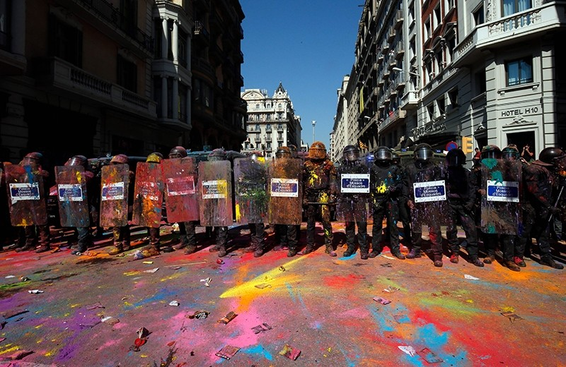 Sept. 29, 2018 file photo shows Catalan regional police officers, covered in paint, standing guard after clashing with separatist protesters during a counter-protest against a demonstration in support of Spanish police in Barcelona. (AFP Photo)