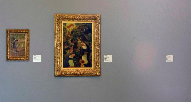 In this Oct. 16, 2012 file photo, the empty space where Henri Matisse' painting La Liseuse en Blanc et Jaune was hanging, right, is seen next to a painting by Maurice Denis, center, and Pierre Bonnard, left,at Kunsthal museum in Rotterdam(AP Photo)