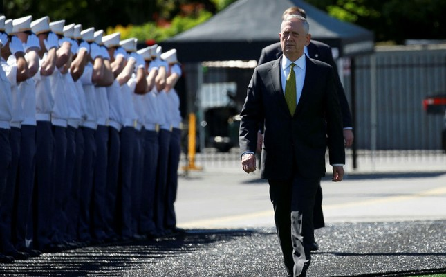 U.S. Secretary of Defense James Mattis walks past saluting cadets as he arrives for commencement ceremonies at the United States Military Academy in West Point, New York, May 27.