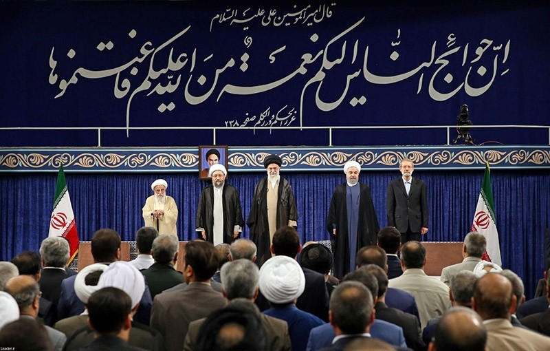 Iran's President Hassan Rouhani stands next to Iran's supreme Leader Ayatollah Ali Khamenei during an endorsement ceremony for Rouhani as a president, in Tehran, Iran August 3, 2017. (Reuters Photo)