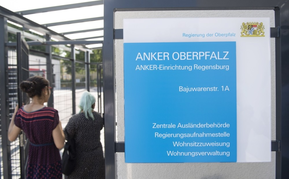 A board which reads u2018Anker Oberpfalz' (Anchor centers) in front of the reception and deportation center for refugees in Regensburg, Bavaria, August 1.