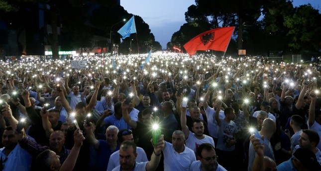 Opposition supporters use light from their cellphones during an anti-government protest, calling on Prime Minister Edi Rama to step down, in Tirana, Albania, June 8, 2019. (Reuters Photo)