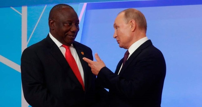 Russian President Vladimir Putin greets South African President Cyril Ramaphosa during the official welcoming ceremony for the heads of state and government at the 2019 Russia-Africa Summit in Sochi on Oct. 23, 2019. (AFP)