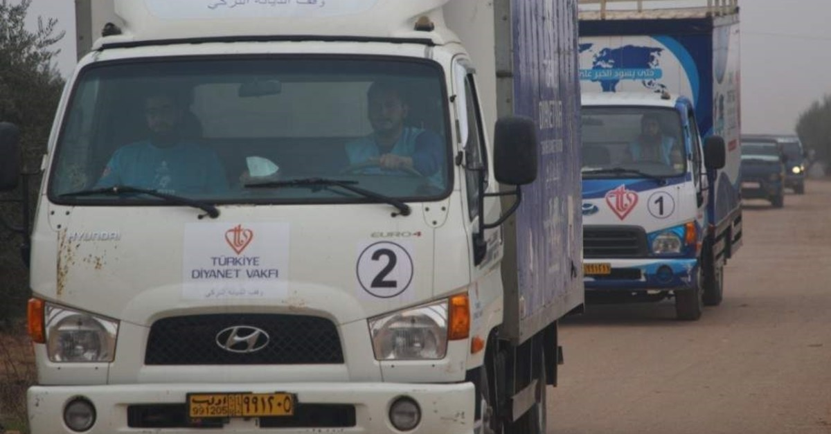 Turkey Diyanet Foundation (TDV) humanitarian aid trucks on their way to Syria after bombings of the Assad regime and its backers on civilians. (TDV - AA Photo)