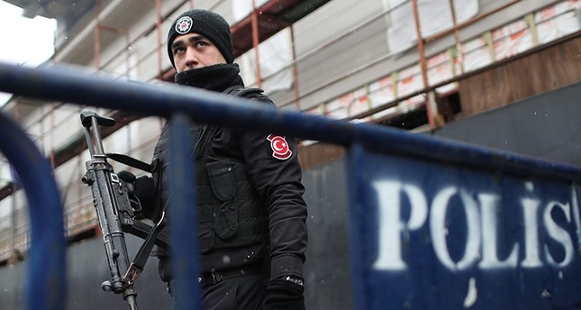 An armed Turkish riot policeman stands guard nearby the site following a gun attack by Daesh on Reina, a popular night club in Istanbul near by the Bosporus, in Istanbul, Jan. 1, 2017. (EPA Photo)