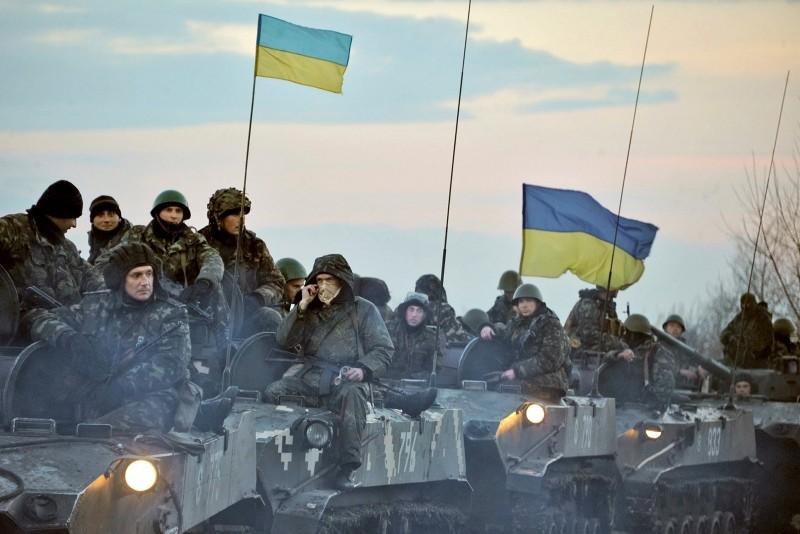 Ukrainian troops ride tanks on the way toward Slovyanks, eastern Ukraine, April 14, 2014. (Photo by Ilia Pitalev Kommersant Photo via Getty Images)