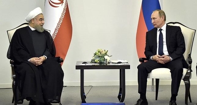 Russian President Vladimir Putin, right, meets with Iranian President Hassan Rouhani in Baku, Azerbaijan on Monday, Aug. 8, 2016 (AP Photo)