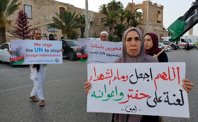 Libyans gather during a demonstration against strongman Khalifa Haftar in the Martyrs Square of the capital Tripoli on June 14, 2019.