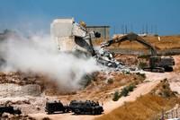 Israeli military demolishes dozens of Palestinian homes in East Jerusalem