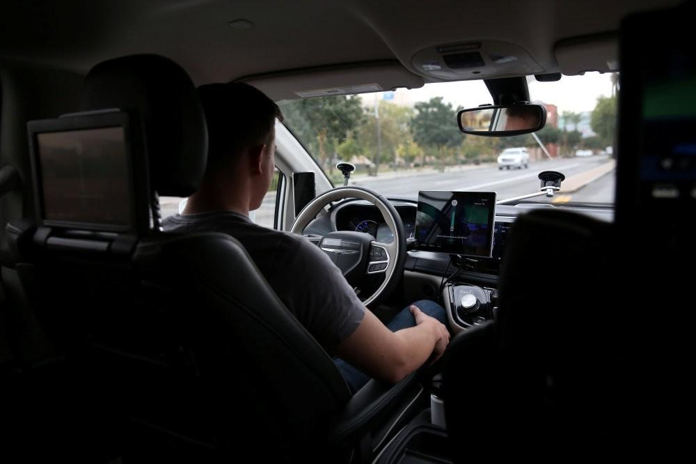 Waymo Trained Driver Derek Sirakis looks forward as the car drives during a demonstration in Chandler, Arizona, Nov. 29.