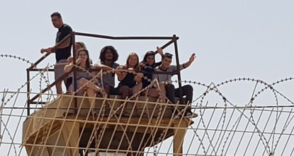 Israelis gather by Gaza border to watch as military uses live fire against Palestinians