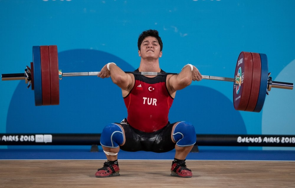 Muhammed Furkan u00d6zbek in action during the Men's 56kg weightlifting competition, Youth Olympic Park, Buenos Aires, Oct. 9.