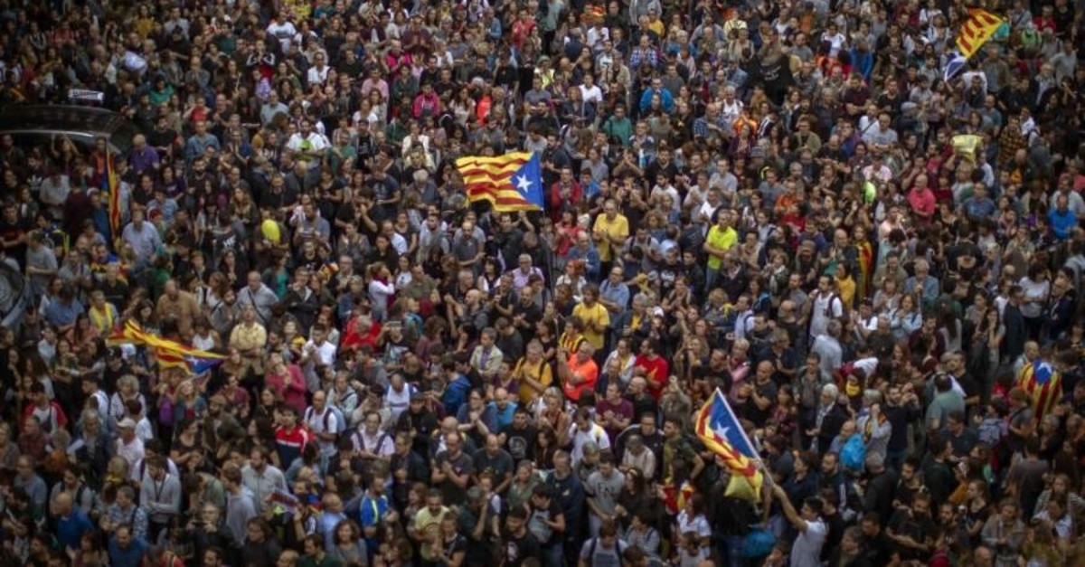 Catalan pro-independence demonstrators gather in front of the Spanish regional government office in Barcelona, Spain, Oct. 20, 2019. AP