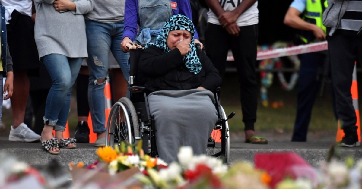 Nasreen Sharifzai (wife of shooting victim Fawad Sharifzai) grieves at a makeshift memorial at the Al Noor Mosque on Deans Road in Christchurch, New Zealand, 19 March 2019 (EPA Photo)
