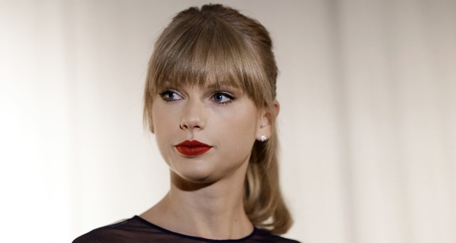 In this Oct. 12, 2103 file photo, Taylor Swift appears at the Country Music Hall of Fame and Museum in Nashville, Tenn. (AP Photo)