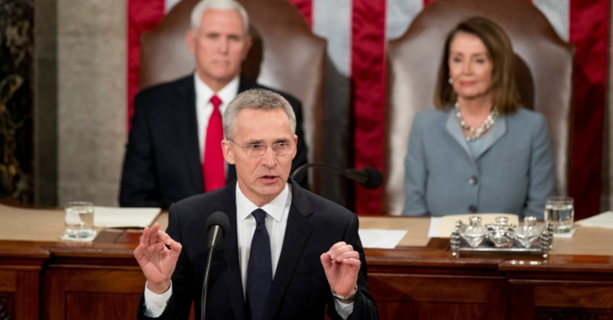 NATO Secretary General Jens Stoltenberg, accompanied by VP Pence and House Speaker Nancy Pelosi, address a Joint Meeting of Congress on Capitol Hill in Washington, Wednesday, April 3, 2019. (AP Photo)