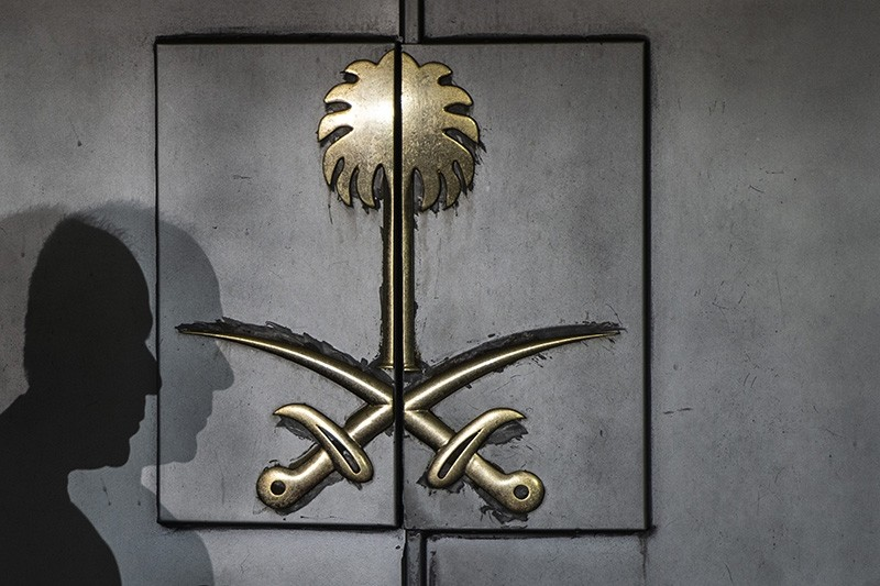 The shadow of a security guard is seen on the entrance door of the Saudi Arabia's consulate in Istanbul, on Oct. 12, 2018. (AFP Photo)
