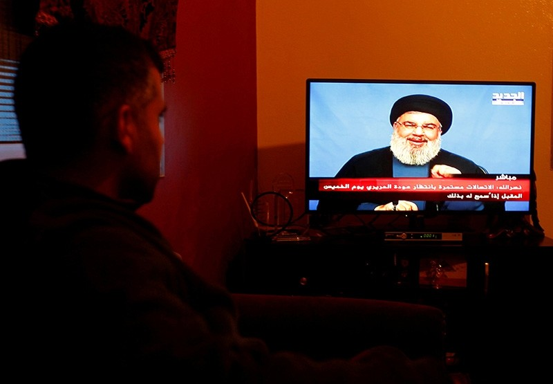 A man watches Lebanon's Hezbollah leader Sayyed Hassan Nasrallah speaking on television in Houla village, southern Lebanon November 5, 2017. (Reuters Photo)
