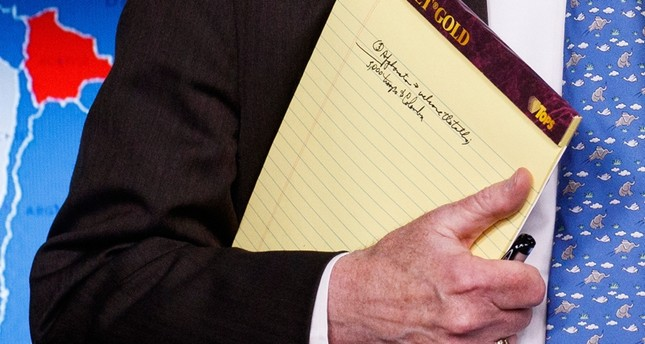 National security adviser John Bolton holds his notes during a press briefing at the White House, Monday, Jan. 28, 2019, in Washington. (AP Photo)