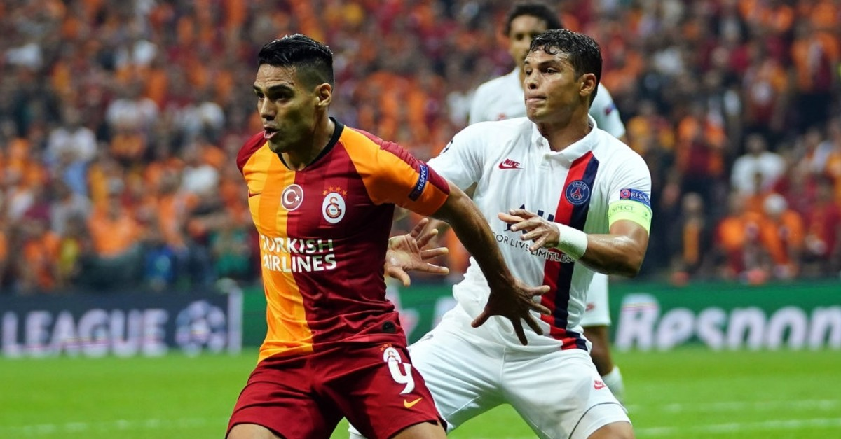 Galatasaray's Radamel Falcao in action with Thiago Silva of Paris Saint-Germain in Istanbul, Oct. 1, 2019.