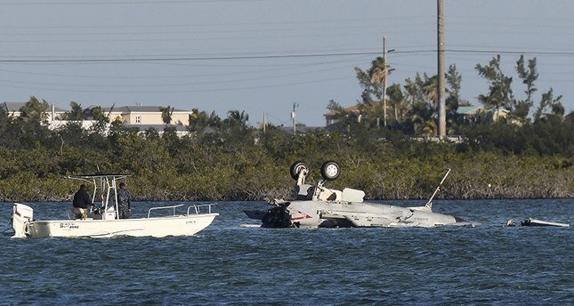 In this March 14, 2018 photo, U.S. Navy personnel respond to a F/A-18 Super Hornet that crashed on its approach to Naval Air Station Key West in Florida. (AP Photo)