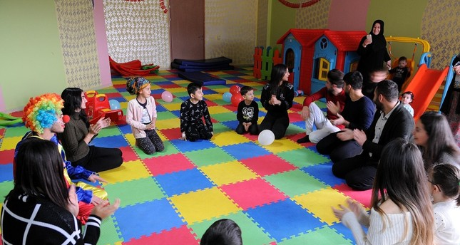 Children gather at the hobby room of the hospital to play games with the volunteers at Bingöl's Maternity and Children's Hospital.