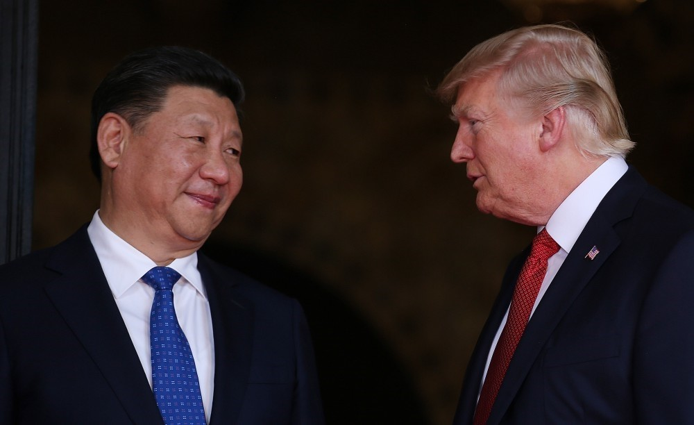 U.S. President Donald Trump welcomes Chinese President Xi Jinping at Mar-a-Lago state in Palm Beach, Florida.