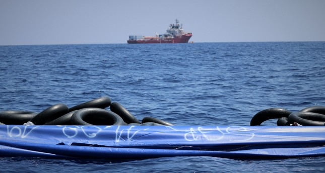 The migrant rescue ship Ocean Viking floats in the distance, as it waits in international waters between August 9 and 12, 2019.