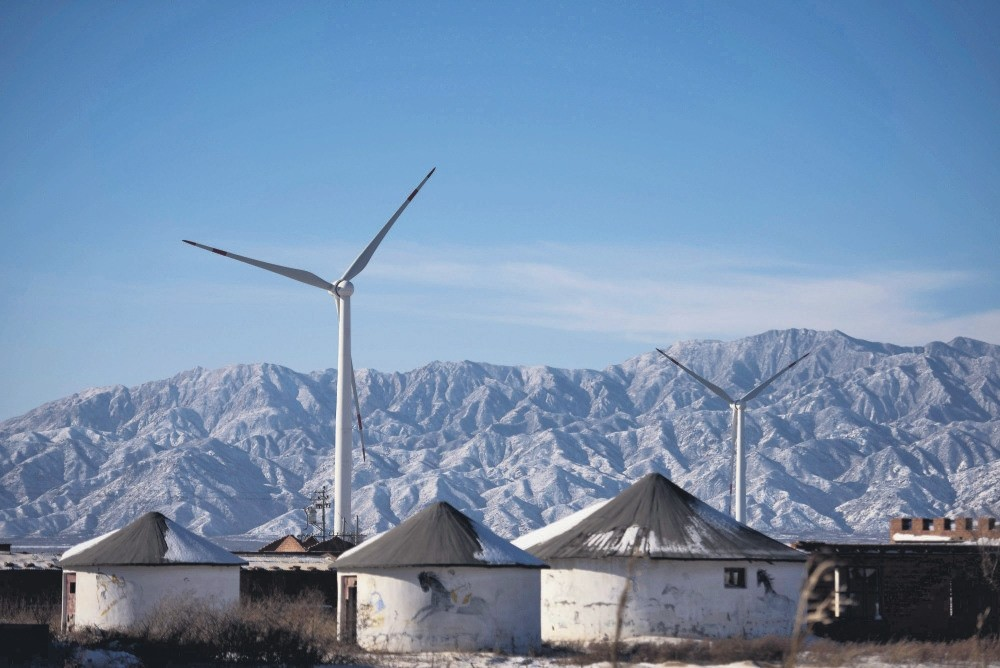 Wind turbines in Guanting, outside of Beijing. China is the worldu2019s biggest polluter and its emissions of the Greenhouse gases that cause climate change is at the center of the future of the planet. (AFP Photo)