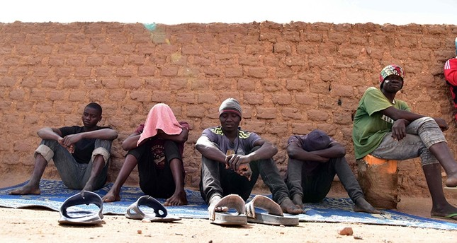 This file photo taken on April 01, 2017 shows  migrants from West Africa waiting in Agadez, northern Niger,  as they wait to go to Libya from where they will attempt to reach Europe by crossing the Mediterranean sea. (AFP Photo)