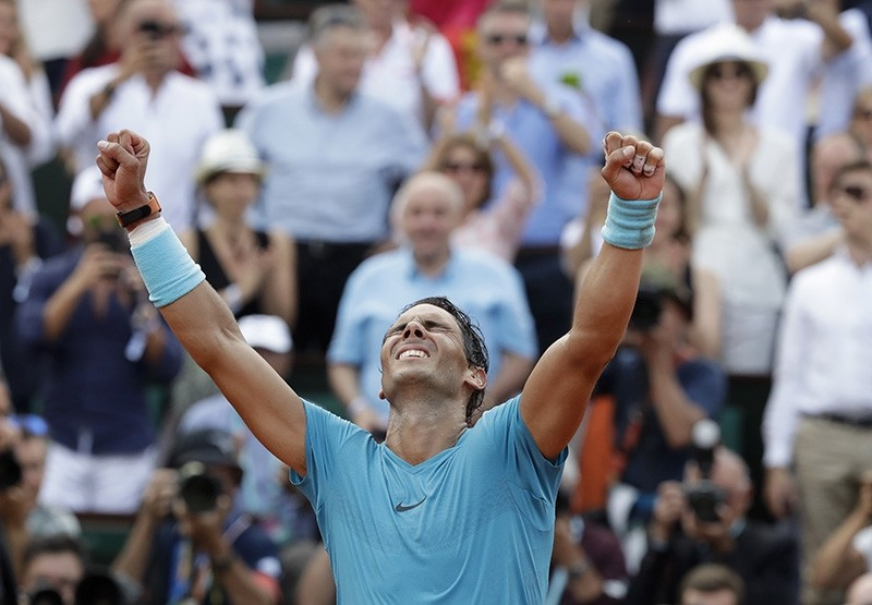 Spain's Rafael Nadal celebrates winning the men's final match of the French Open tennis tournament against Austria's Dominic Thiem in three sets 6-4, 6-3, 6-2, at the Roland Garros stadium in Paris, France, Sunday, June 10, 2018. (AP Photo)