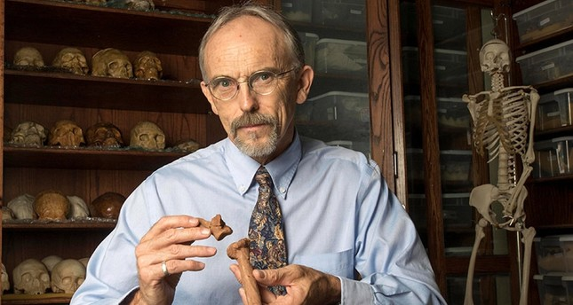 Paleoanthropologist John Kappelman is seen with 3D printouts of Lucy's skeleton in this image from the University of Texas at Austin, U.S.  (Reuters Photo)