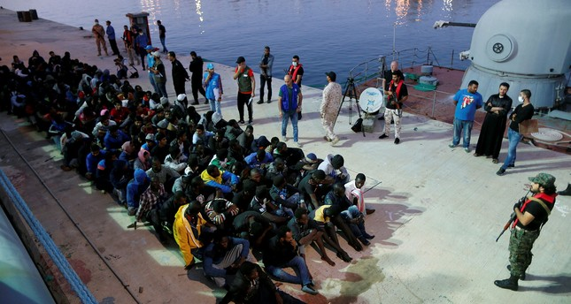 Migrants arrive at a naval base after they were rescued by the Libyan navy, Tripoli, Nov. 4.