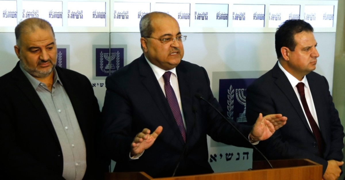 Members of the Joint List Ayman Odeh, center, speaks to the press in the presence of Ahmad Tibi, right, and Mansour Abbas, following their consulting meeting with Israeli President Reuven Rivlin, in Jerusalem, Sunday, Sept. 22, 2019. (AP Photo)