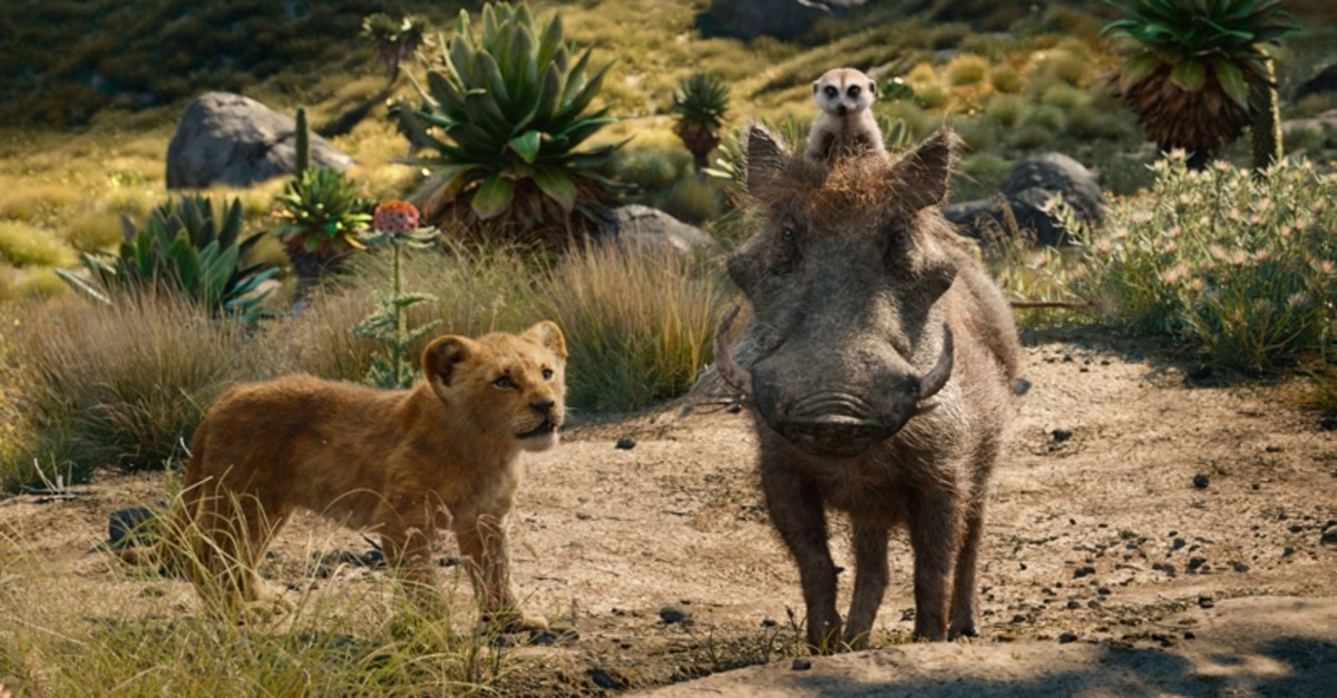 This file image released by Disney shows, from left, young Simba, voiced by JD McCrary, Timon, voiced by Billy Eichner, and Pumbaa, voiced by Seth Rogen, in a scene from ,The Lion King., (AP Photo)