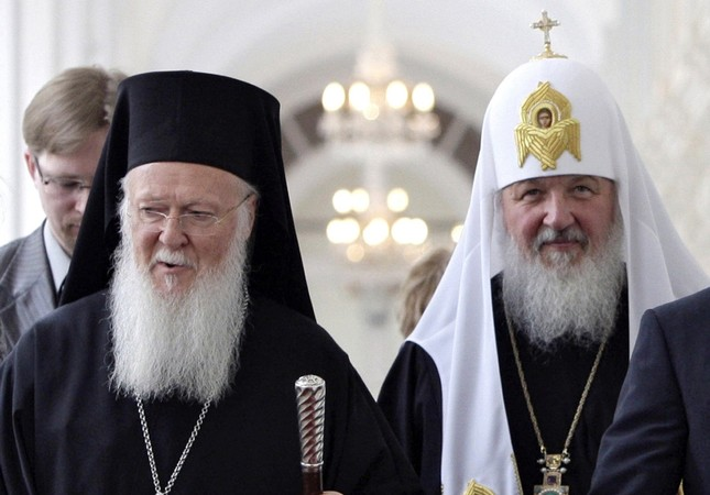 In this Tuesday, May 25, 2010 file photo, Ecumenical Patriarch Bartholomew I of Constantinople L and Russian Orthodox Patriarch Kirill tour the Kremlin during a meeting in Moscow, Russia. Dmitry Astakhov, Sputnik, Govt Pool Photo via AP